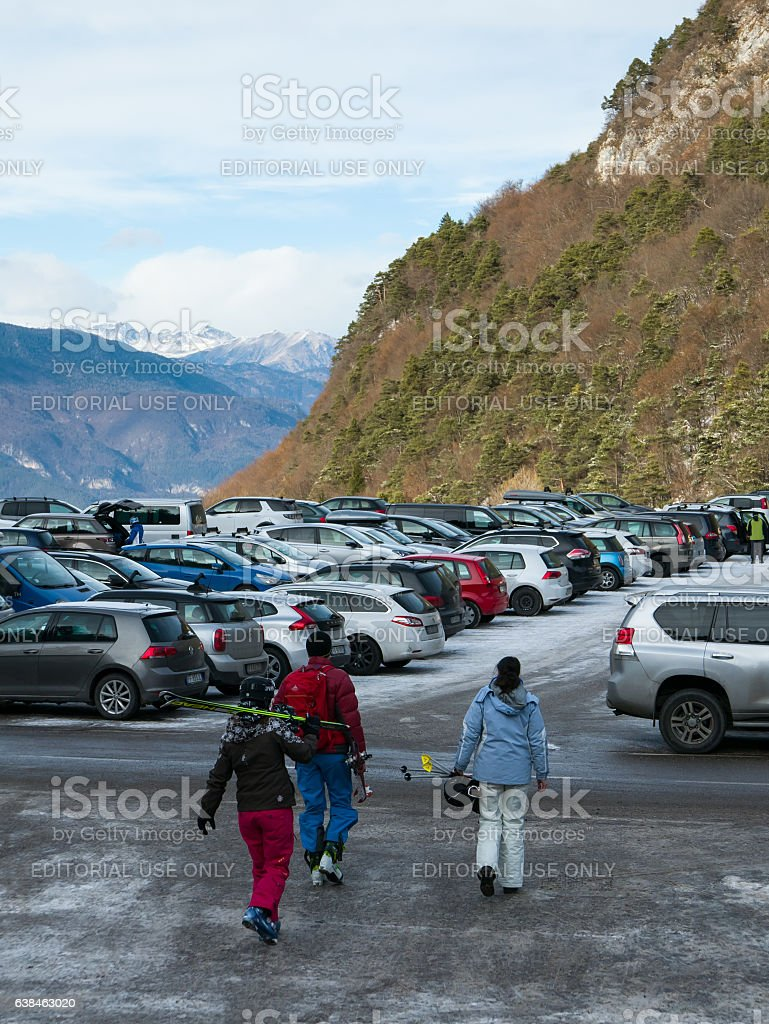 Busy parking lot in the mountain ski resort stock photo
