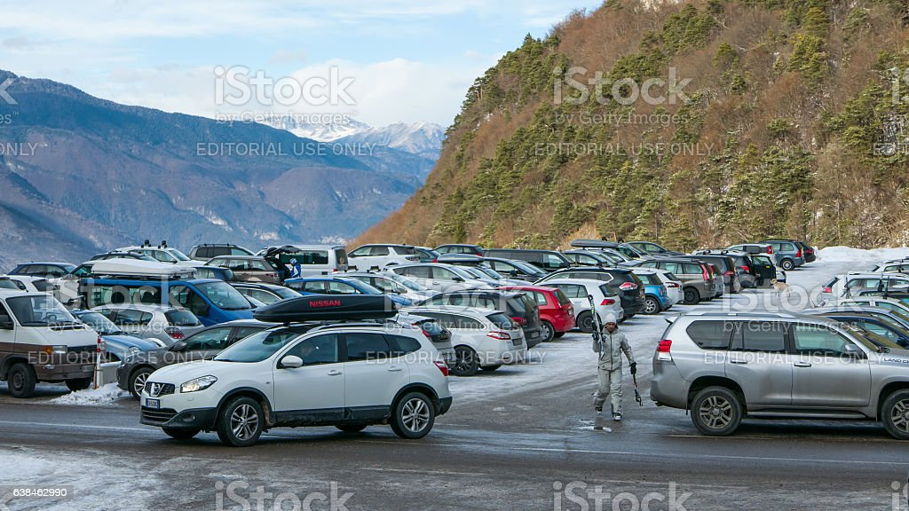 Busy parking lot in the mountains stock photo