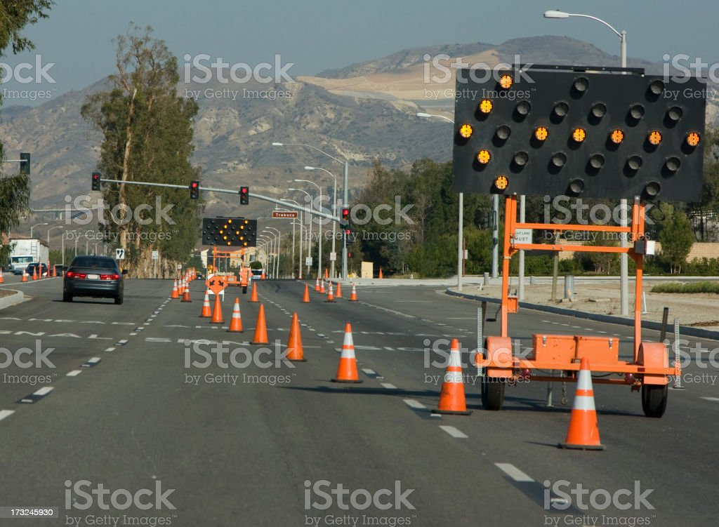 A busy road experiencing road work stock photo