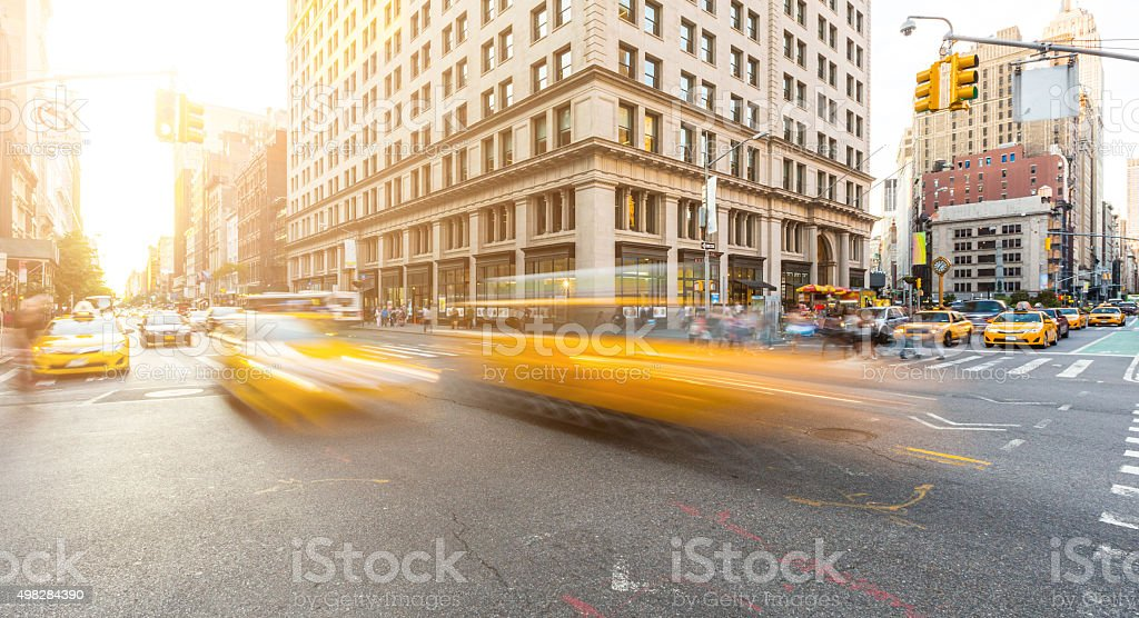 Busy road intersection in Manhattan, New York, at sunset stock photo