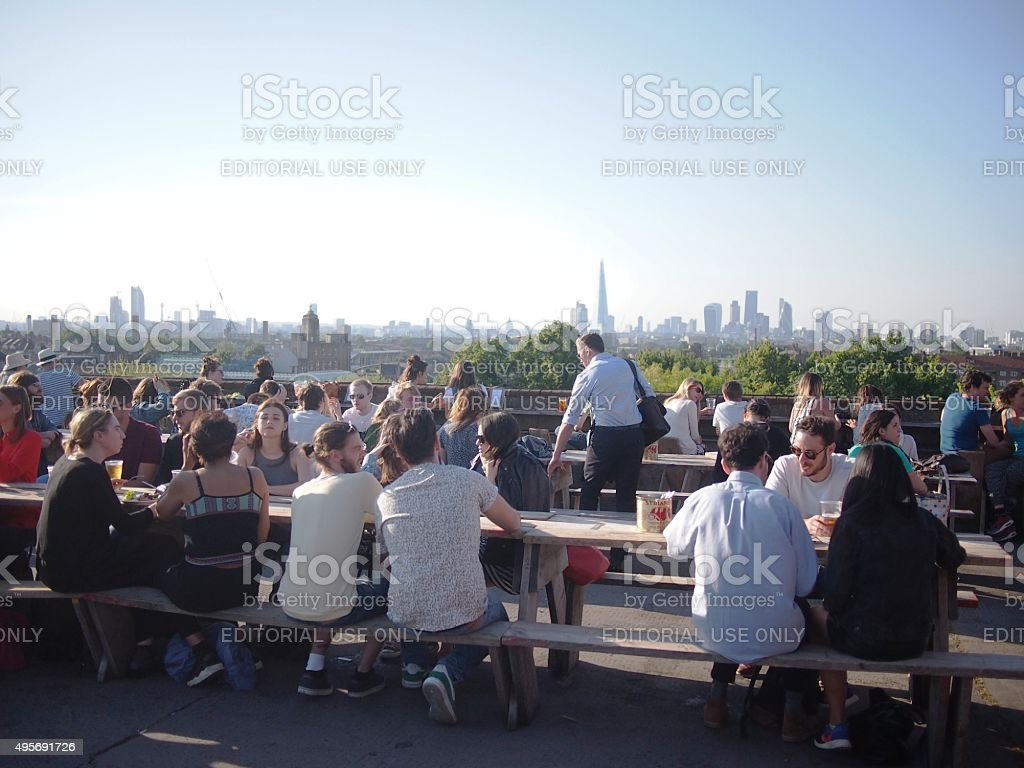 Busy Rooftop Bar in London on Hot Summer's Day stock photo