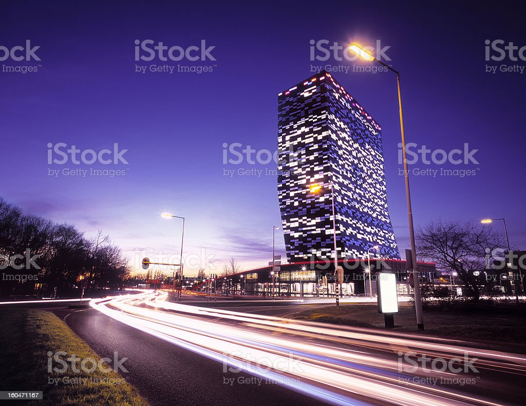 Busy rush hour traffic passing modern office building. royalty-free stock photo