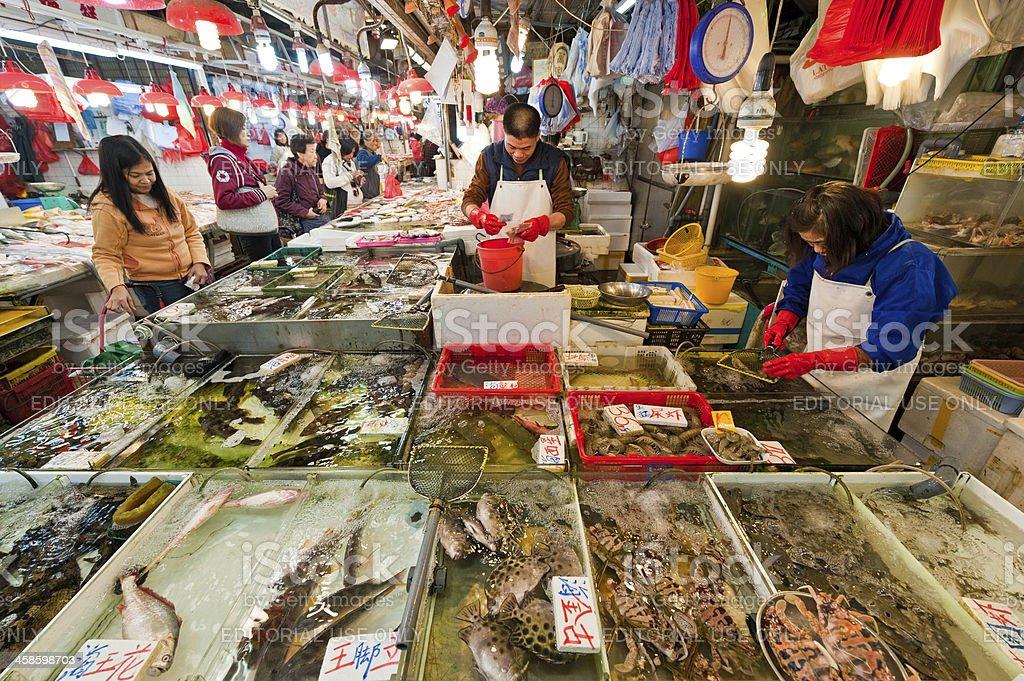 Busy seafood fish market Chinese shoppers fishmongers Hong Kong China royalty-free stock photo