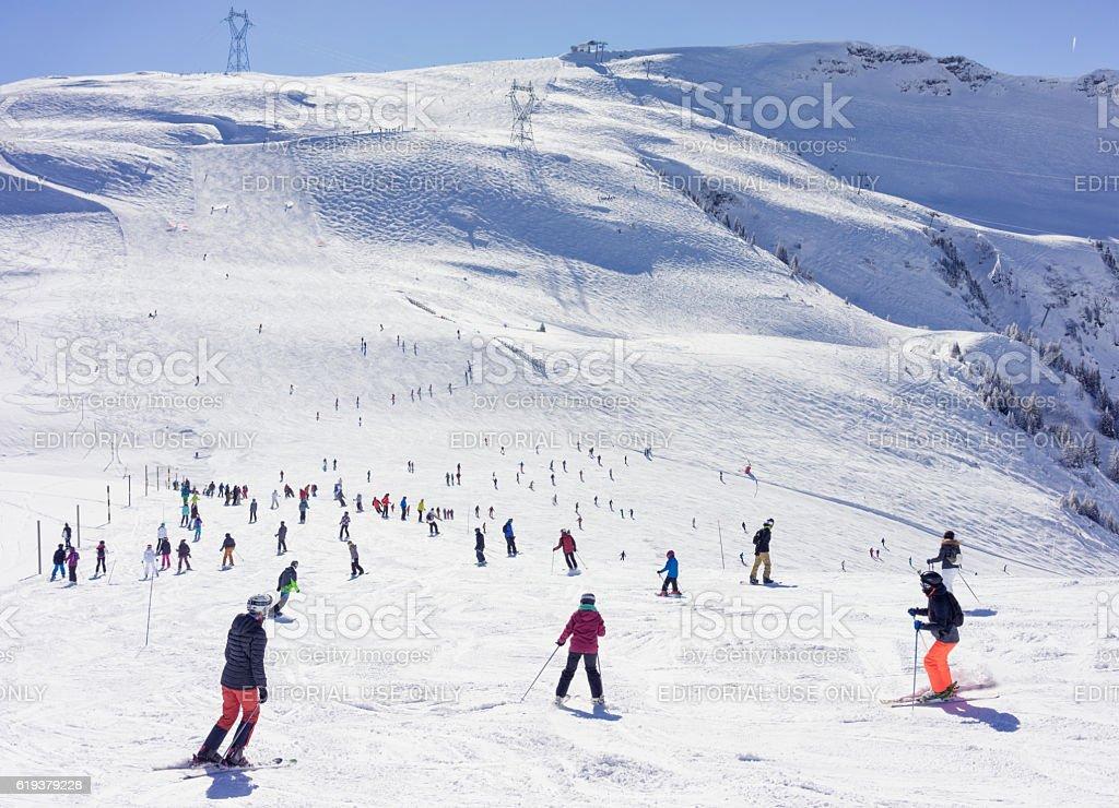 Busy ski piste in the French Alps stock photo