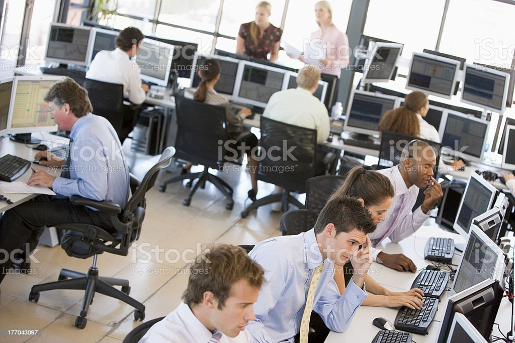 Busy stock traders in office stock photo