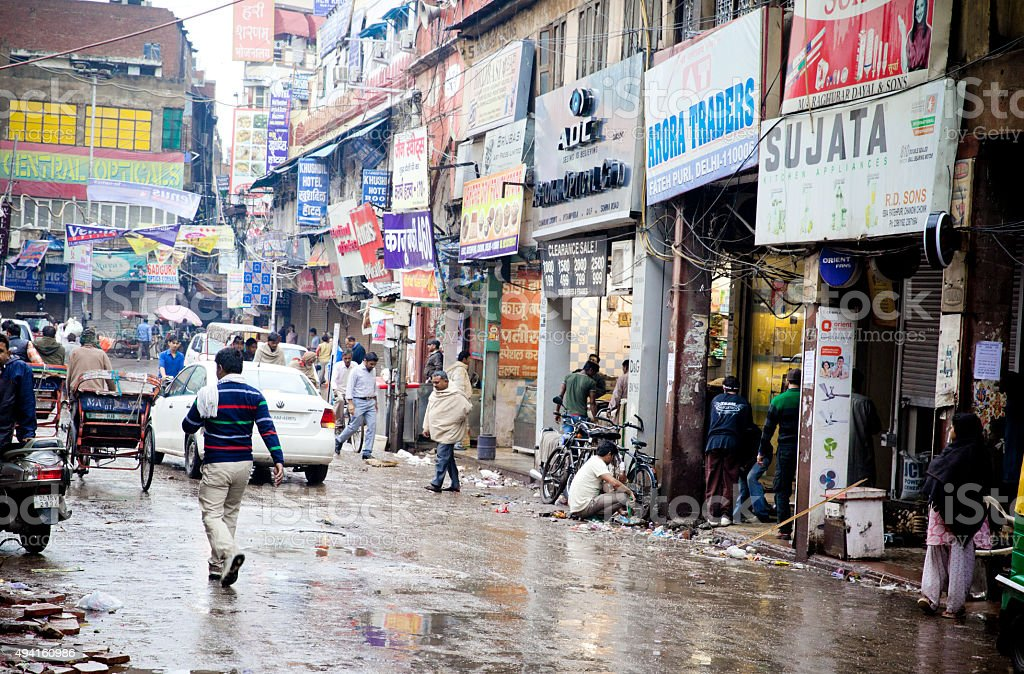 Busy street, Old Delhi on a rainy day stock photo