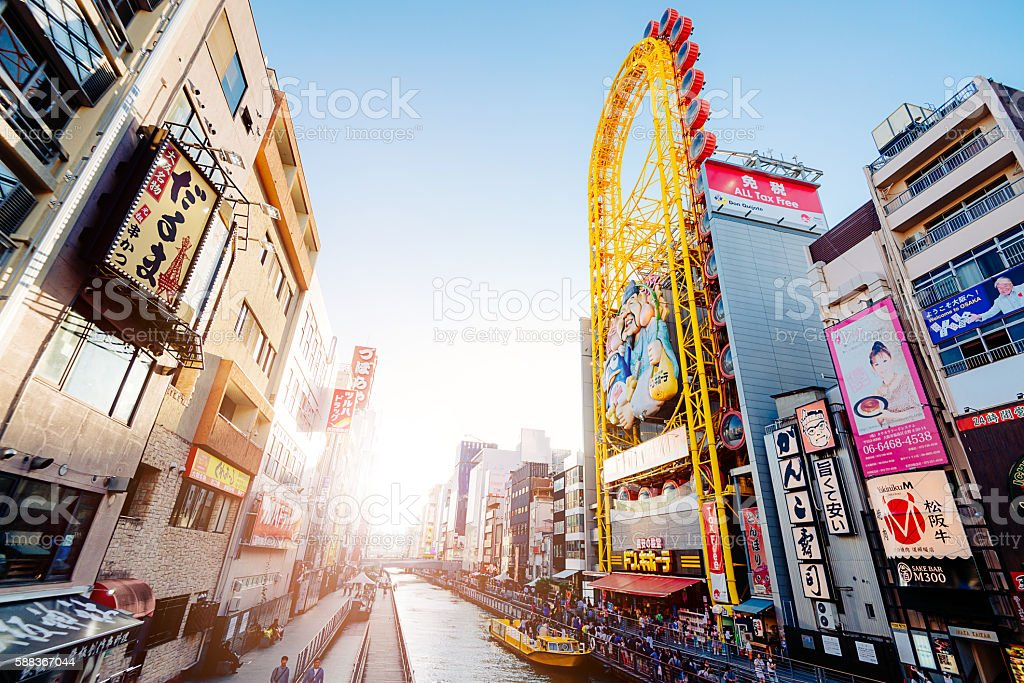 Busy street with tourists and pedestrians in Dotonbori, Osaka stock photo