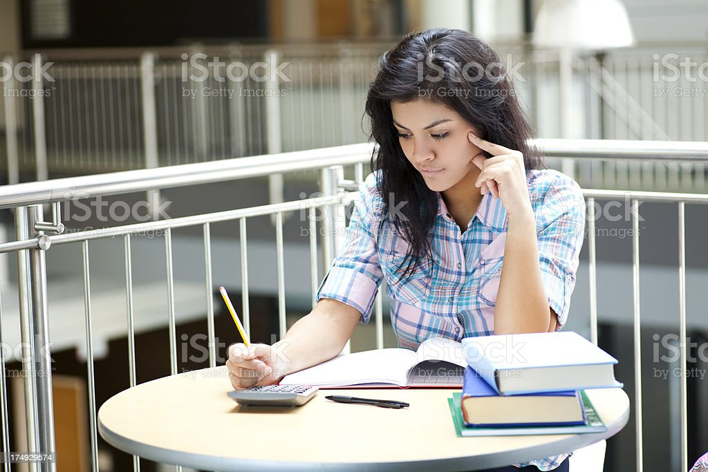 Busy student doing homework royalty-free stock photo