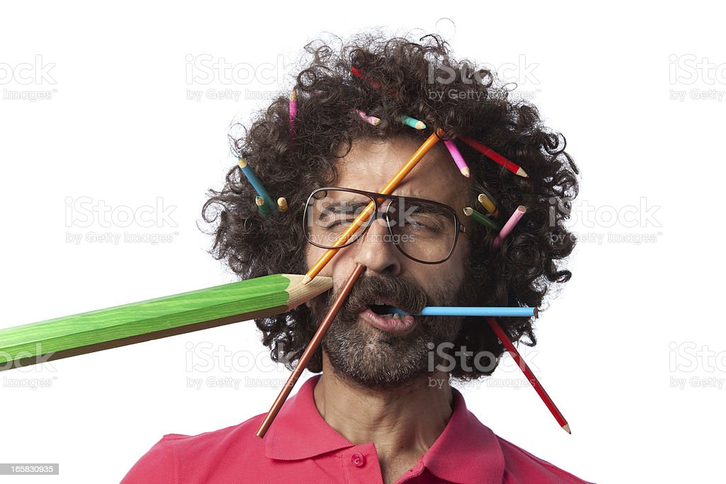 Busy teacher confronting flying pencils royalty-free stock photo