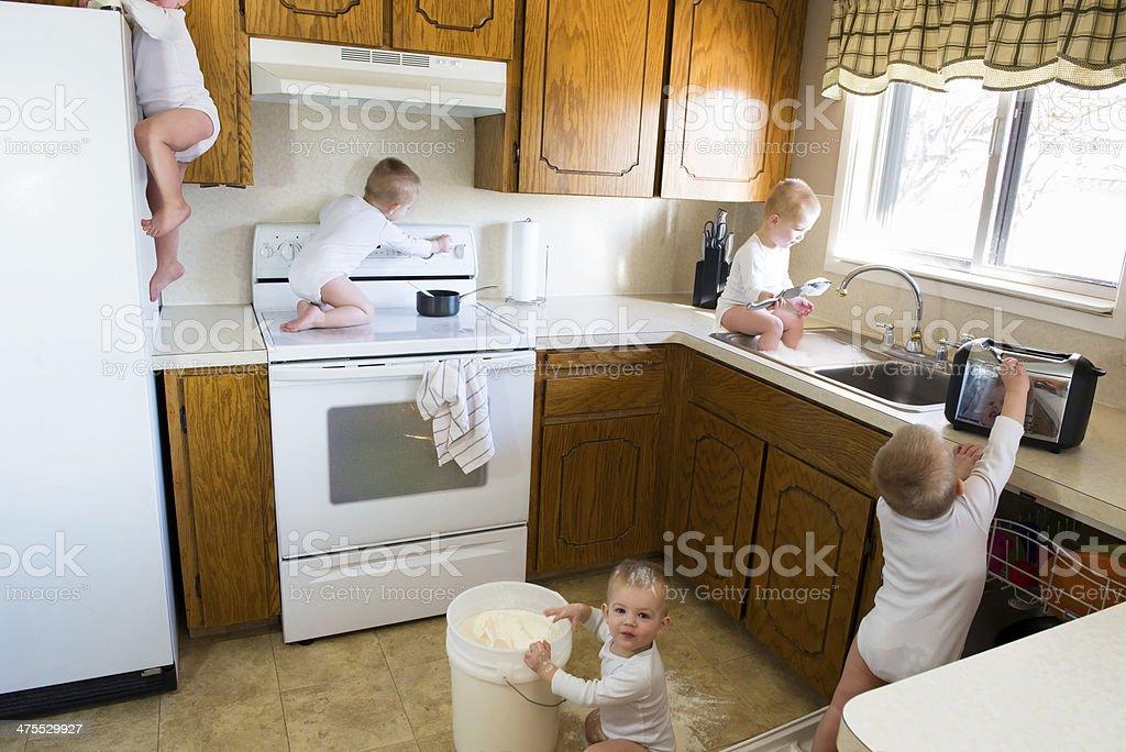 Busy Toddler Destroys Kitchen stock photo