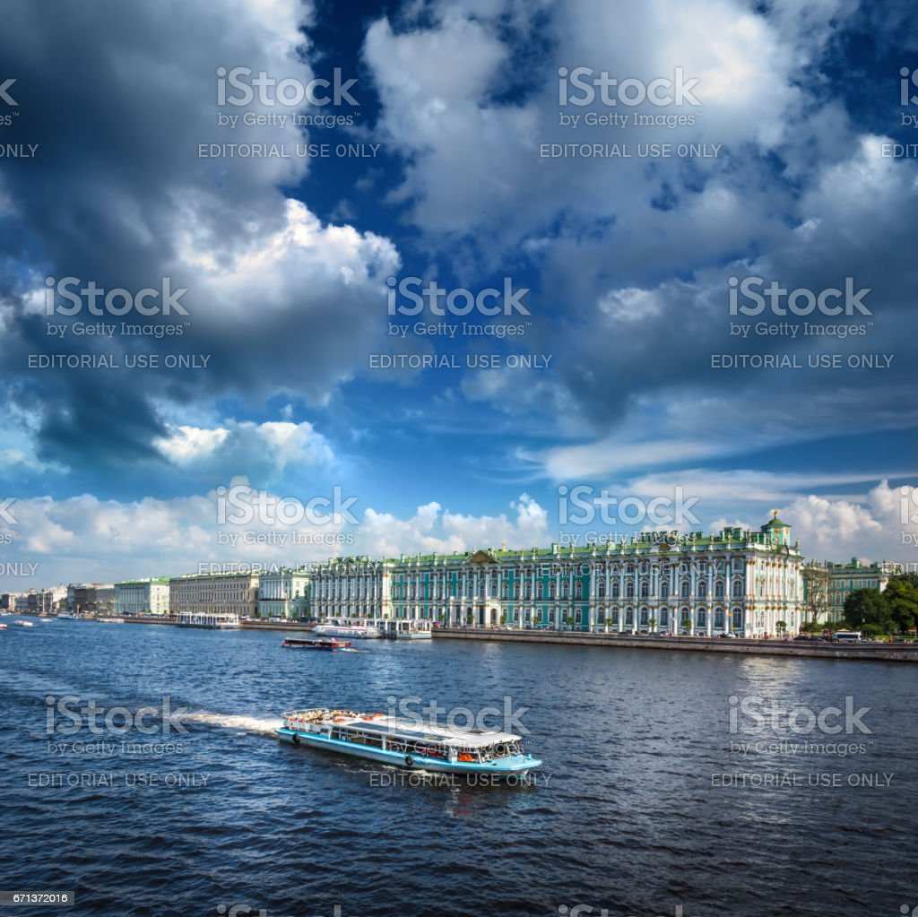 Busy traffic of boats on the Neva against the background of the Hermitage Museum and the Rostral Columns. stock photo