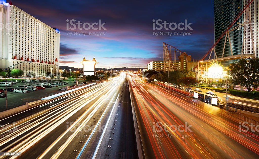 busy traffic on road and modern buildings in purple sky stock photo