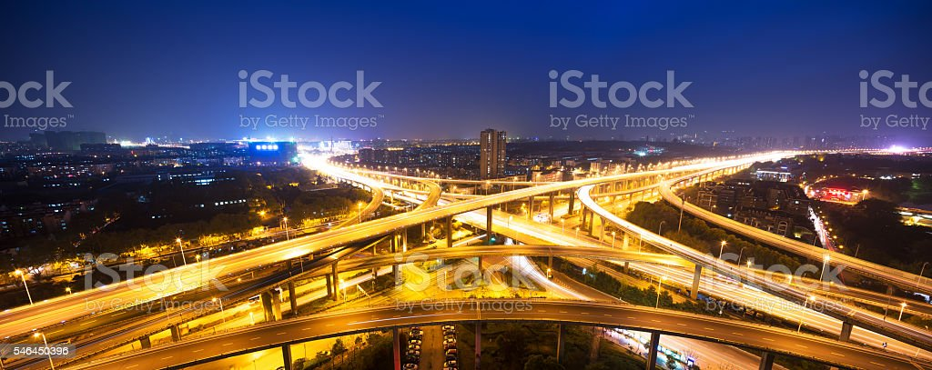 busy traffic on road junction in downtown of hangzhou night stock photo