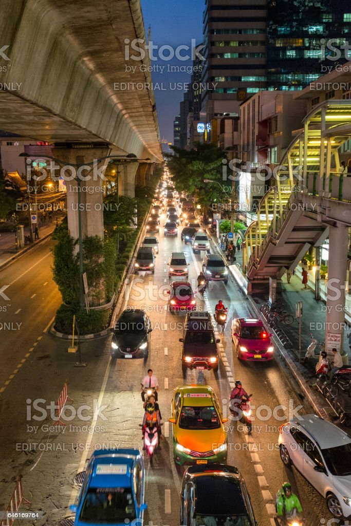 Busy Traffic Under The Elevated Train Track In Bangkok, Thailand stock photo