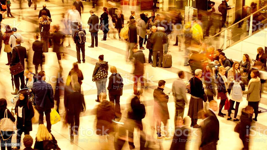 Busy train station during rush hour stock photo