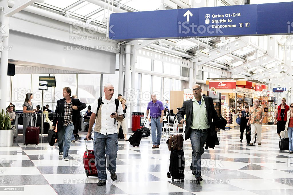 Busy Travelers at O'Hare International Airport stock photo
