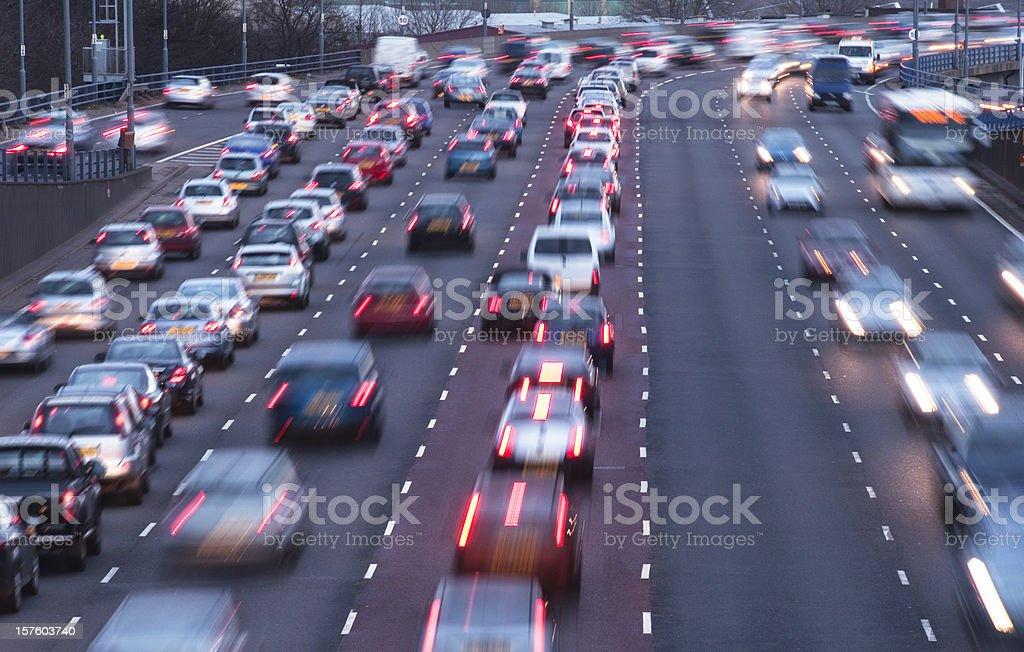 Busy urban motorway at dusk royalty-free stock photo