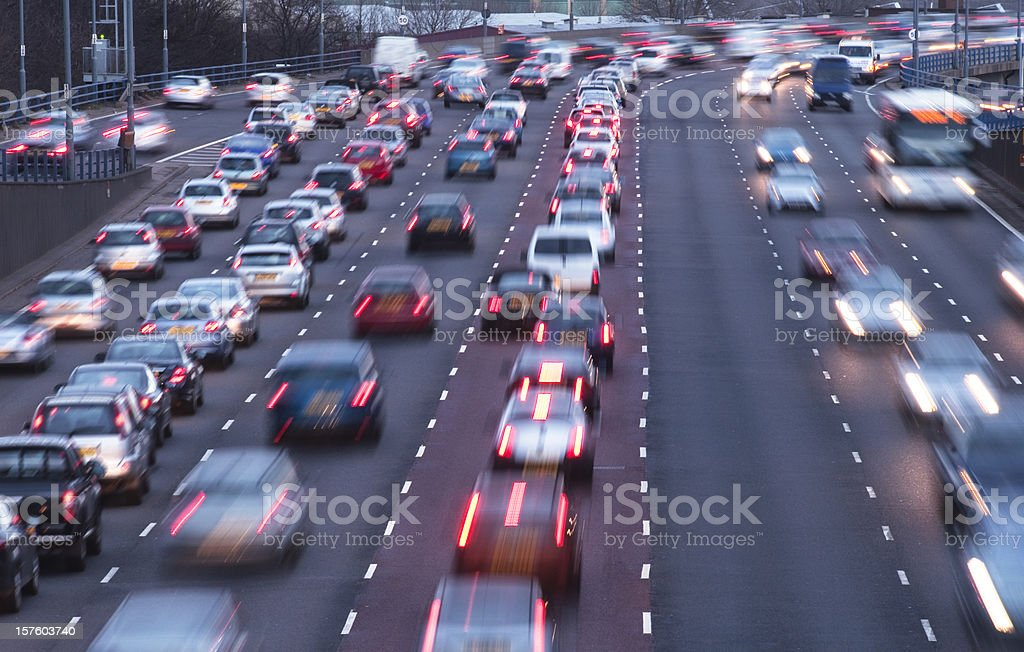 Busy urban motorway at dusk stock photo