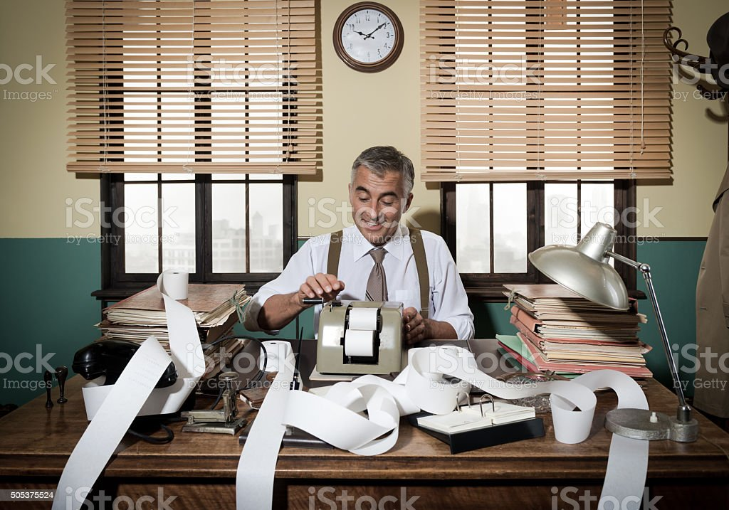 Busy vintage accountant with calculator stock photo