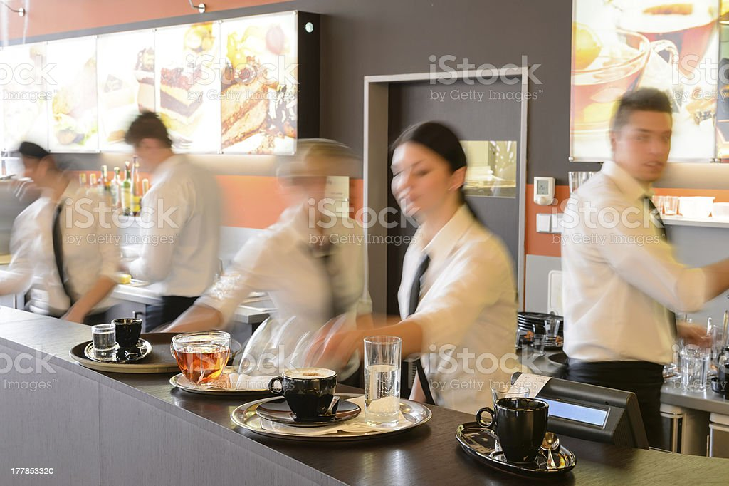 Busy waiter and waitresses working at bar stock photo