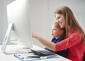 Busy woman with child in office