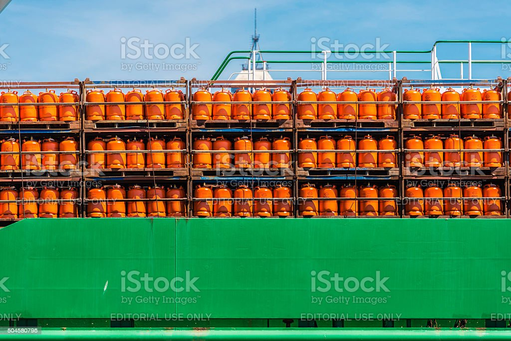 butane cylinders in a boat stock photo