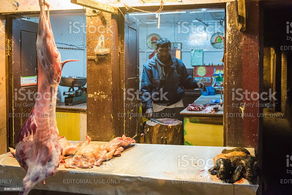 Butcher chopping goats and chickens at roadside stall Kathmandu Nepal stock photo