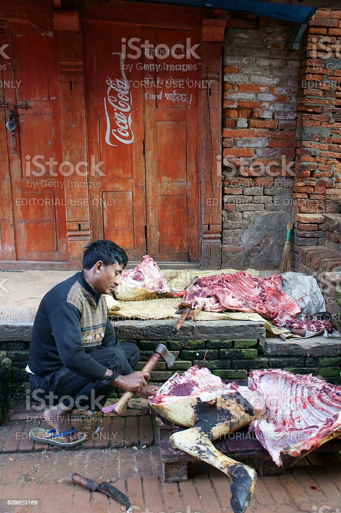 butcher cutting a buffalo, sacrificed during dashain festival ti stock photo