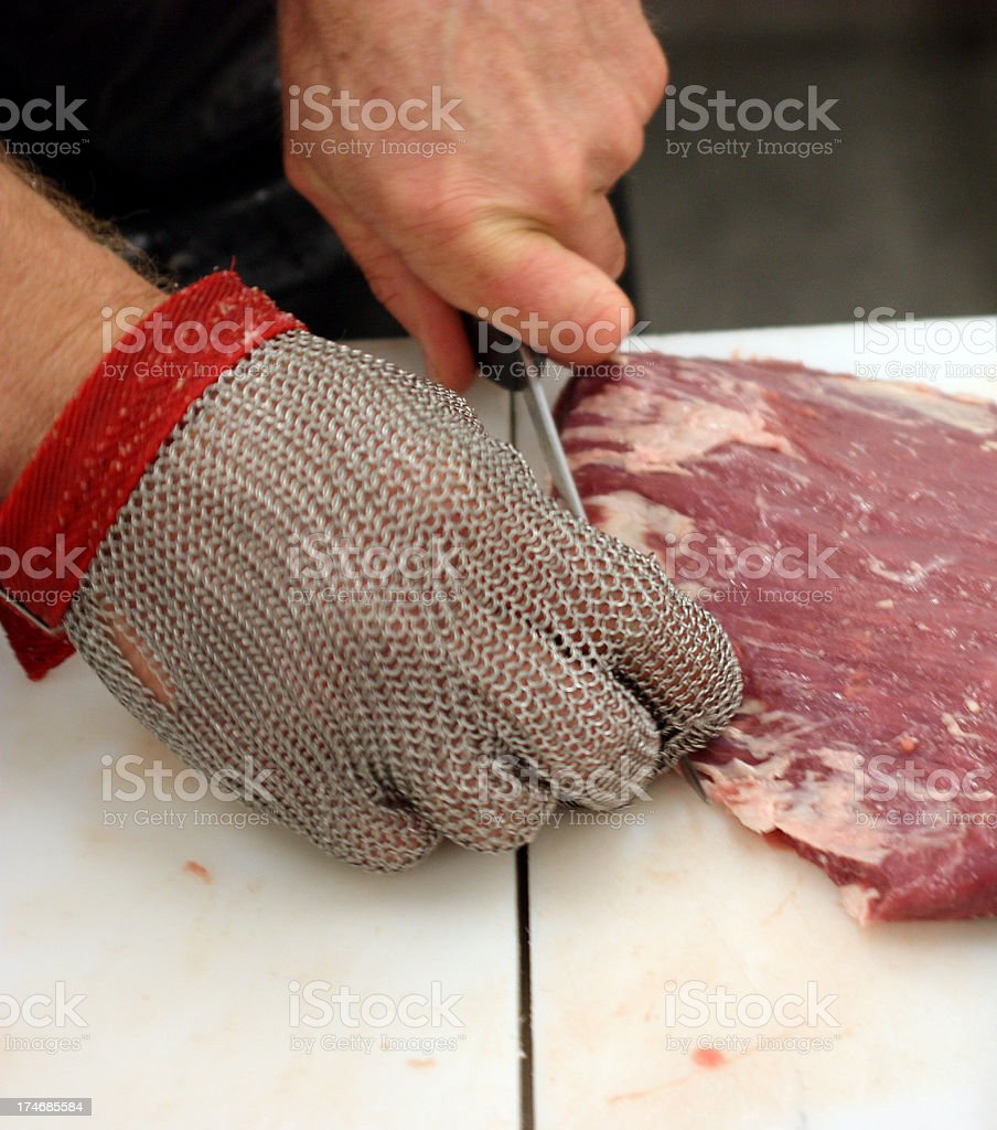 Butcher Cutting Beef royalty-free stock photo