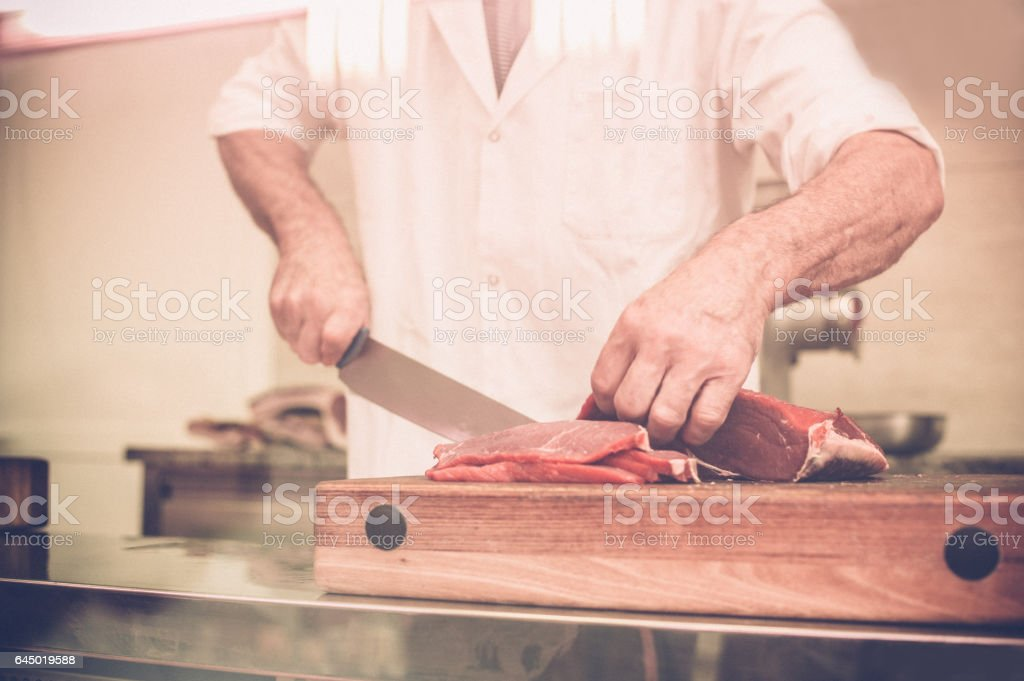 Butcher Cutting the Steaks stock photo
