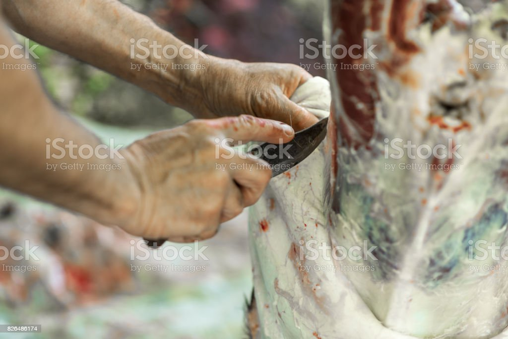 Butcher disassembles carcass of young veal, work process, stock photo