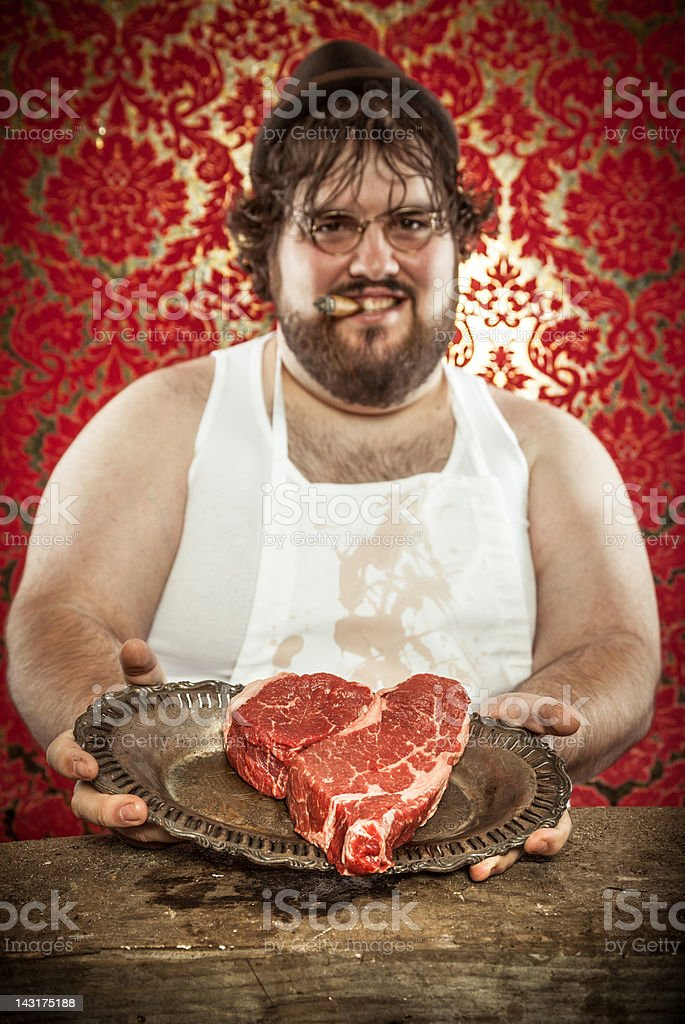 Butcher Holding a Heart Shaped Steak for Valentines DAy royalty-free stock photo