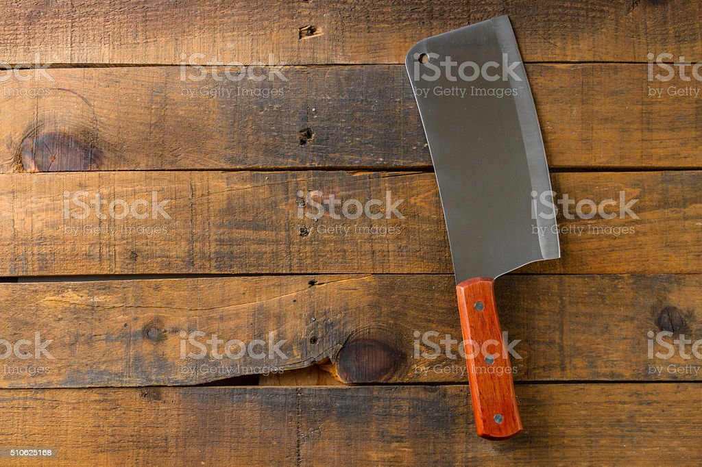 Butcher knife on wood background stock photo