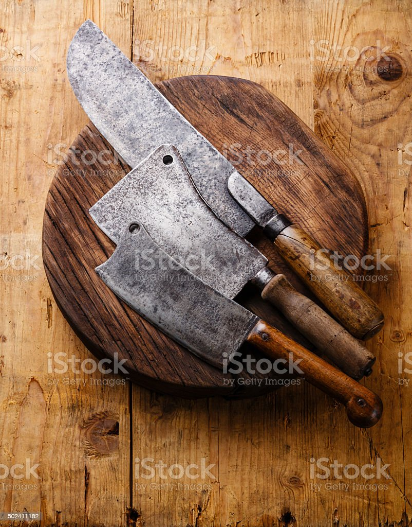 Butcher Meat cleavers on Chopping block stock photo
