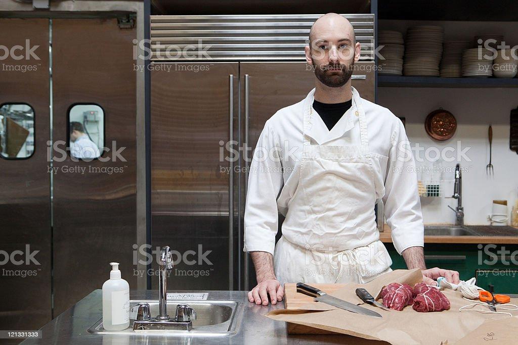 Butcher preparing beef tenderloin stock photo