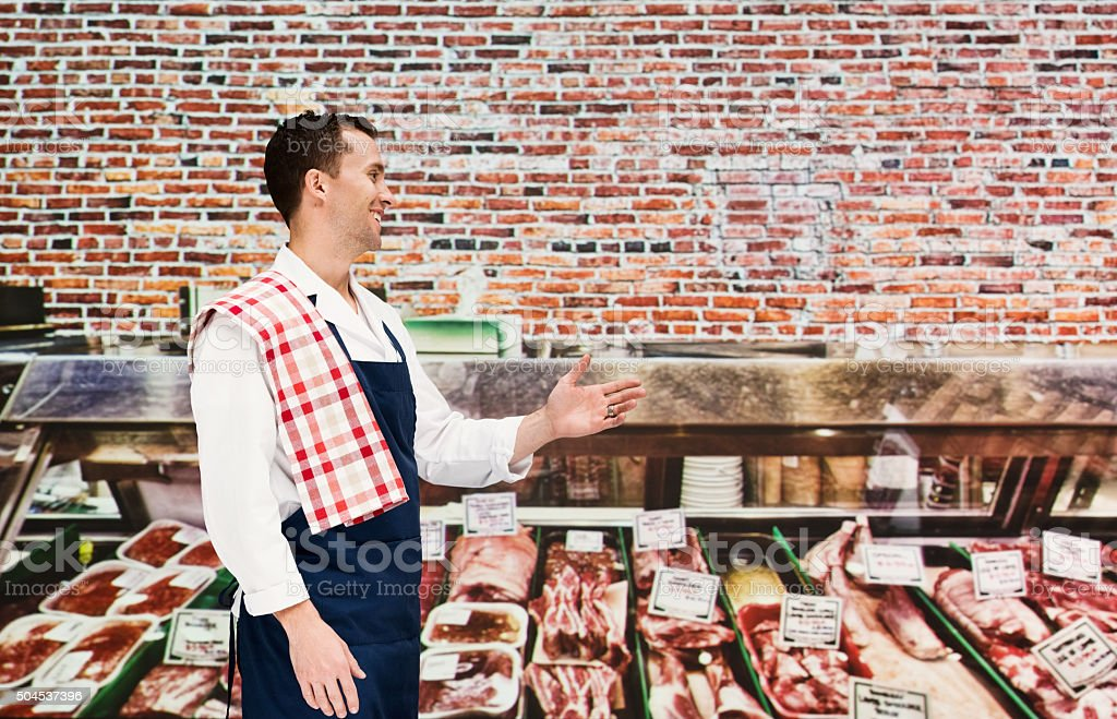 Butcher selling ground meat stock photo