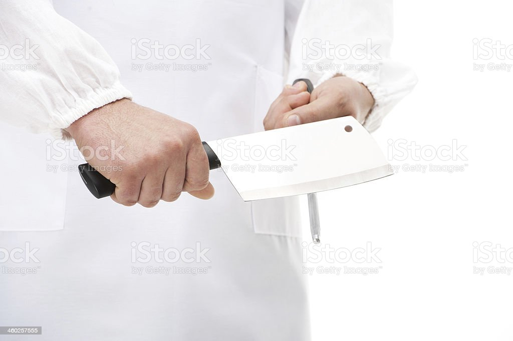 Butcher sharpening a cleaver. royalty-free stock photo