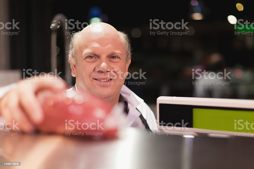 Butcher weighing meat stock photo