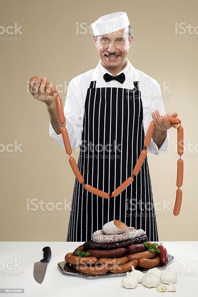 Butcher With String Of Sausage Links stock photo