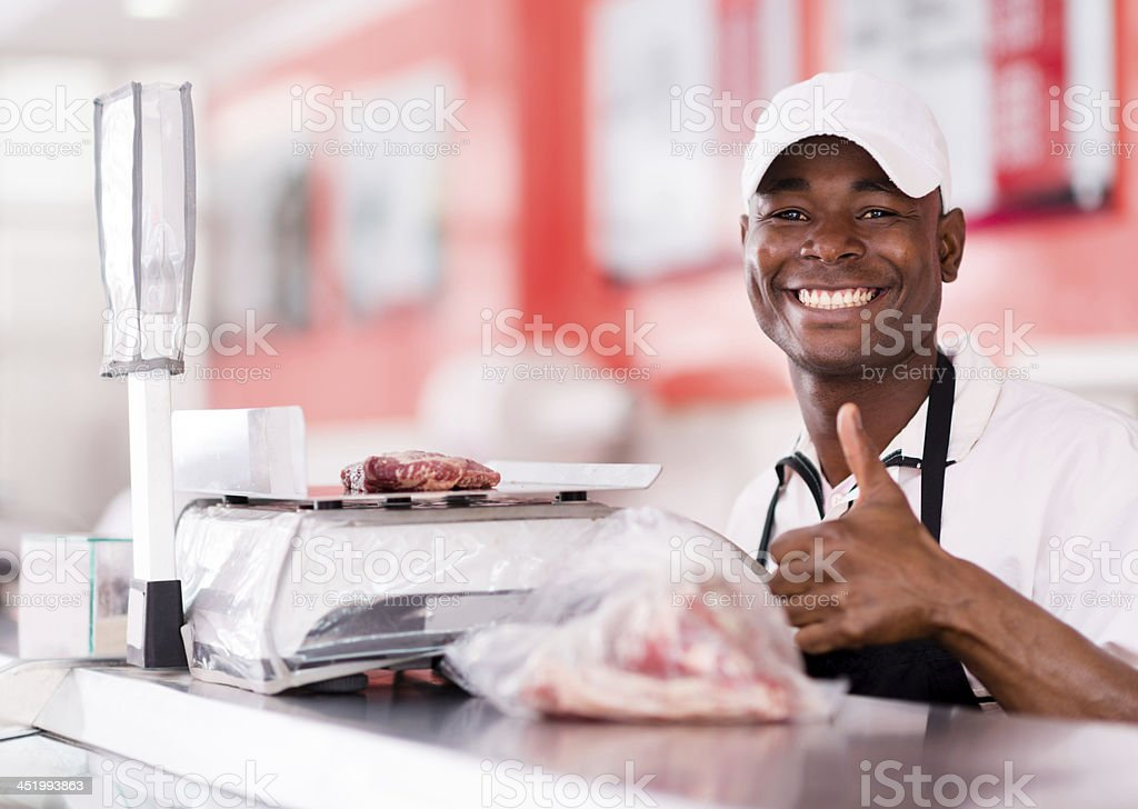 Butcher with thumbs up stock photo