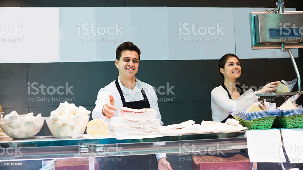 Butchers offering salo and meat stock photo