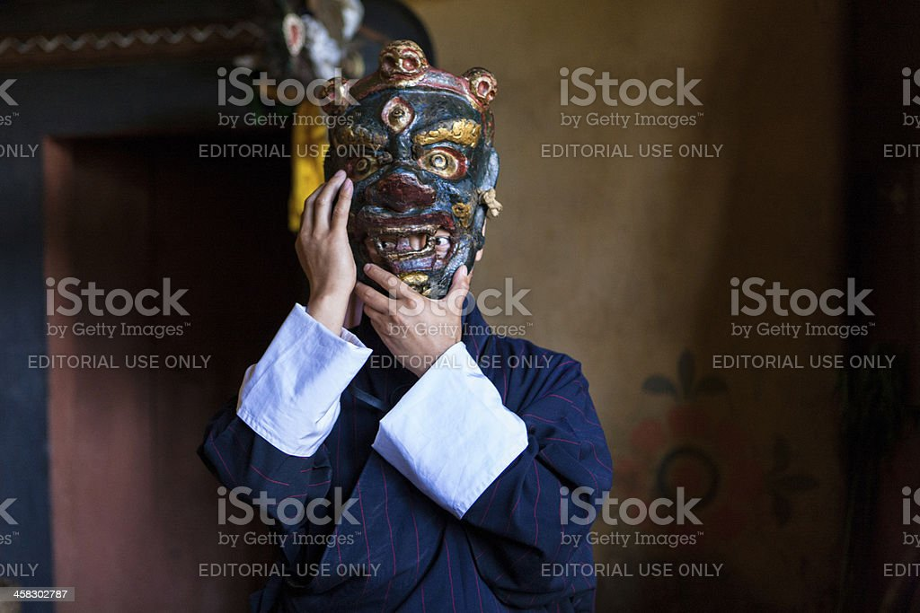 Buthanese man with traditional mask for fire festival in Thangbi stock photo