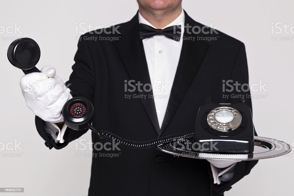 Butler handing you a telephone royalty-free stock photo