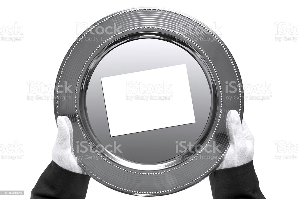Butler holding a silver tray, shot from above stock photo