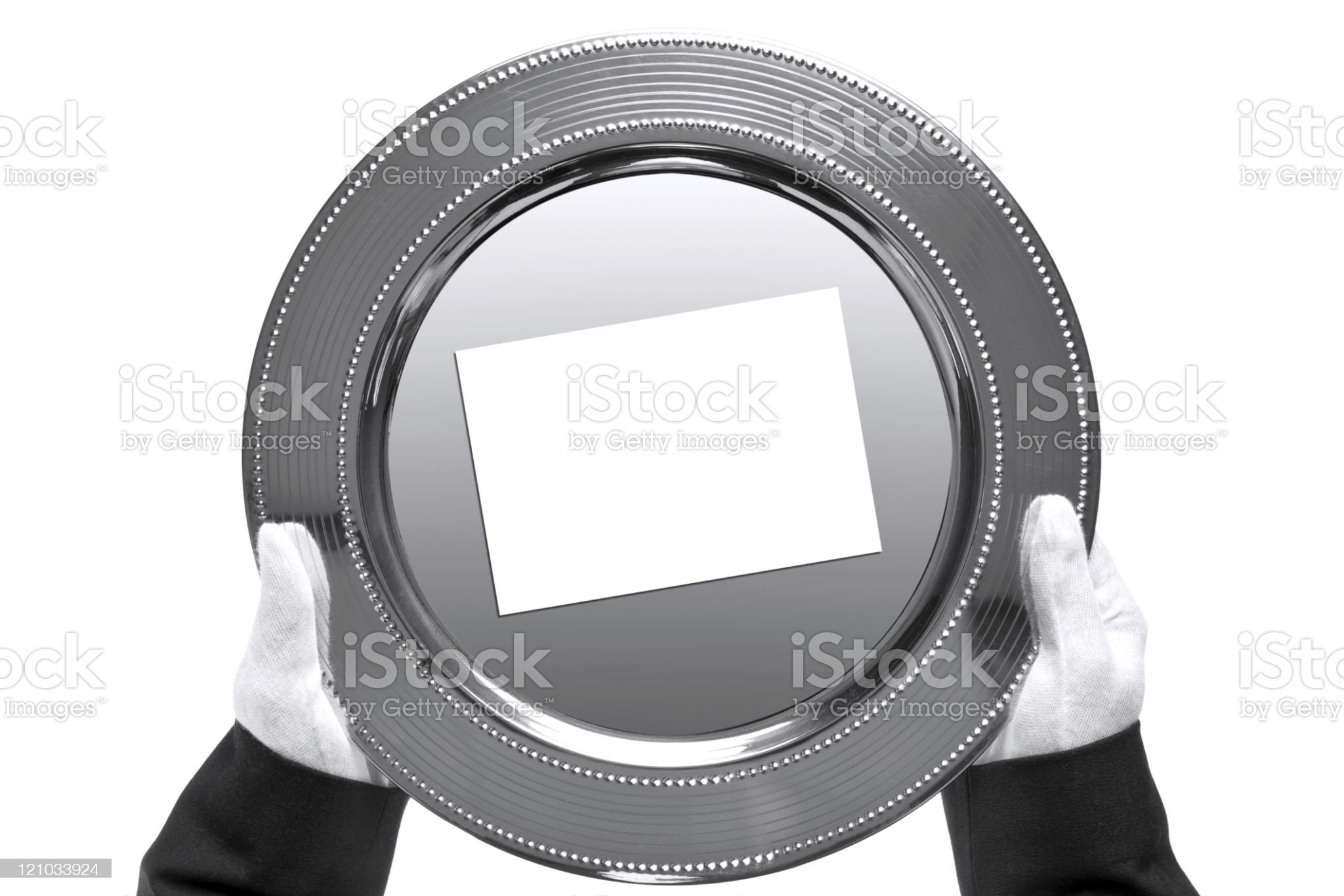 Butler holding a silver tray, shot from above royalty-free stock photo