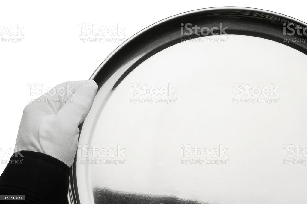 Butler holding an empty silver serving tray on white background royalty-free stock photo