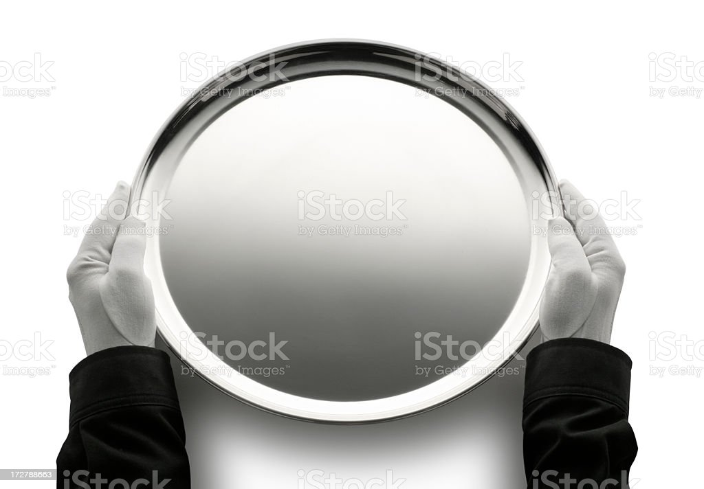 Butler holding an empty silver serving tray stock photo
