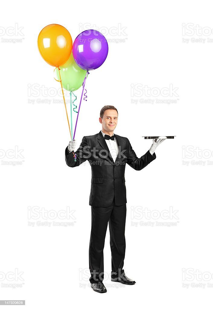 Butler holding an empty tray and balloons royalty-free stock photo