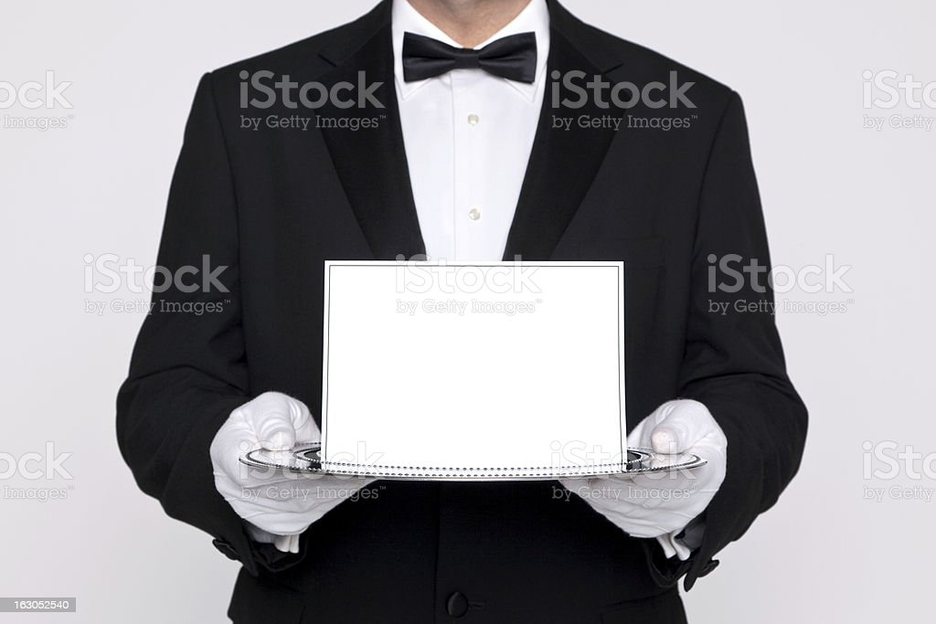 Butler holding blank card upon a silver tray stock photo