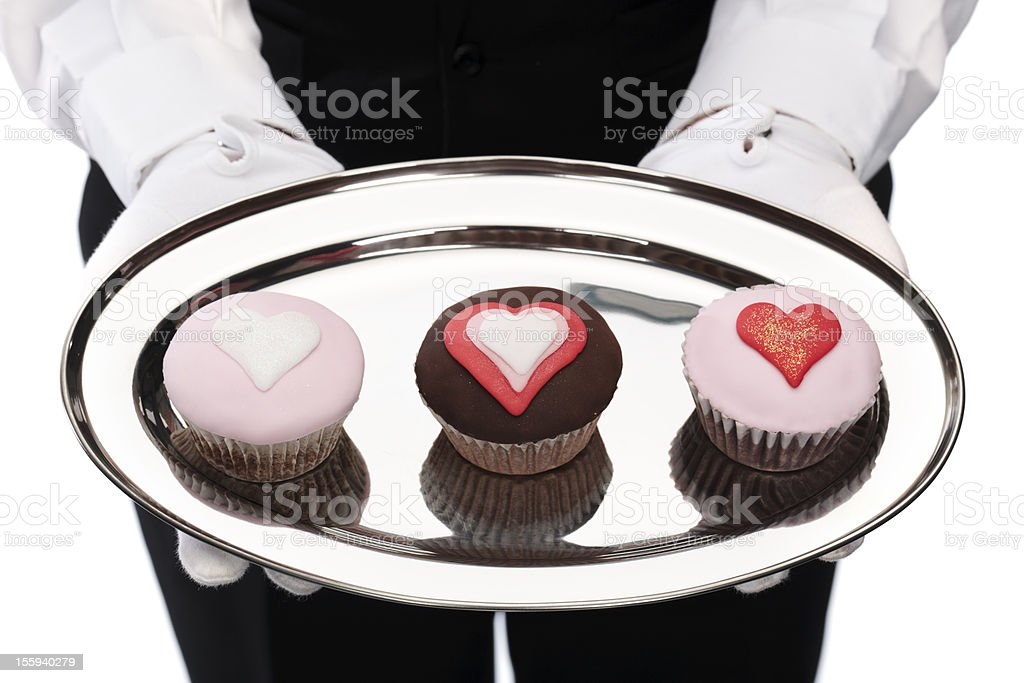 butler holding cupcakes stock photo